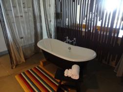 Banheira no meio do quarto